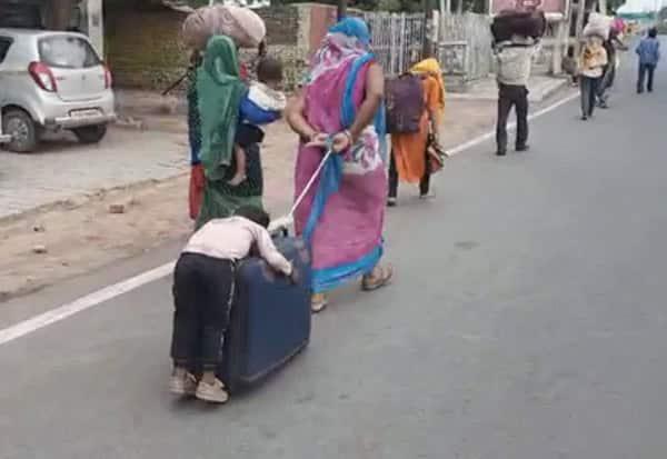 migrants, suitcase, dragged, mother,son, sleeping, migrant worker, Uttar Pradesh, Agra